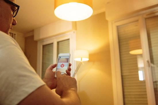 Smart phone controlling San Diego home lighting control system