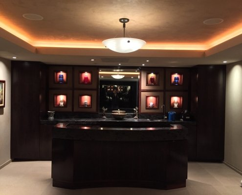 Chandelier and puck lighting for home bar