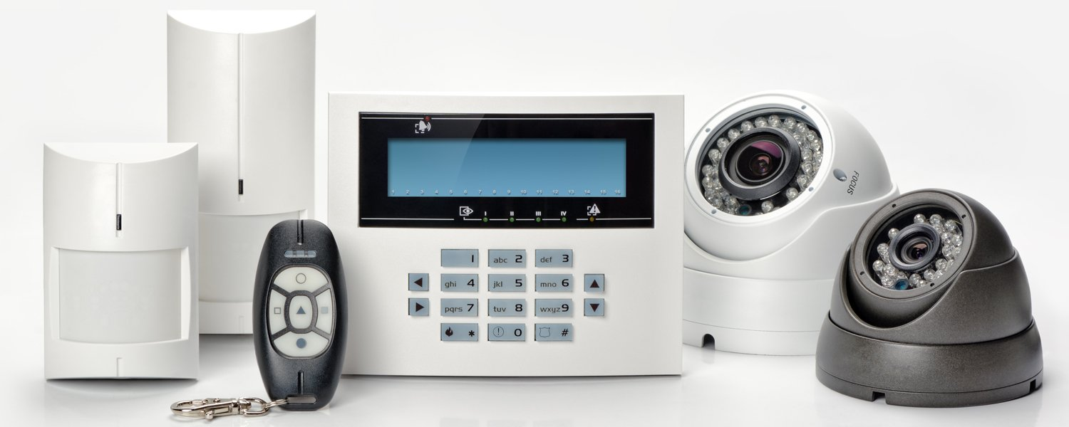 Various home security monitors, remotes and cameras